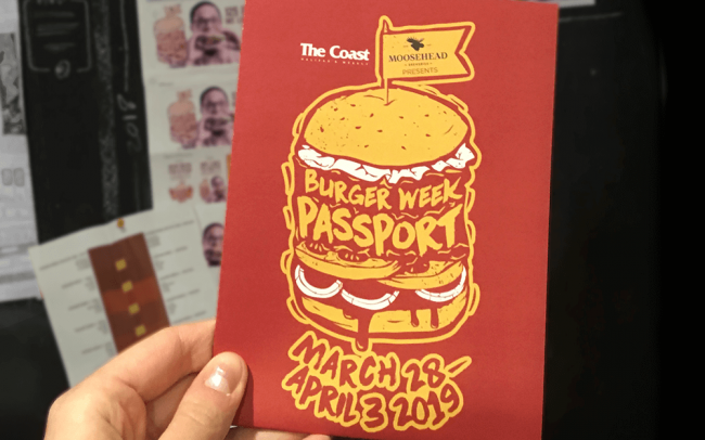 Halifax Burger Week Passport being held up in front of burger week moodboard